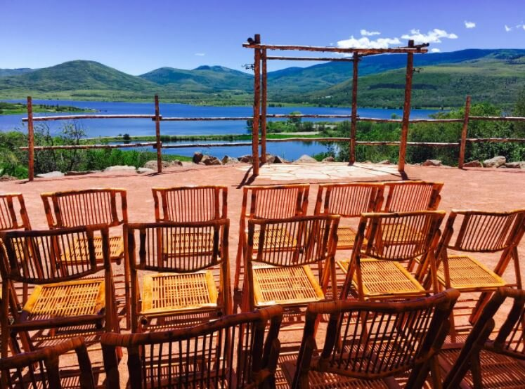 Wedding reception seating with lake in a backdrop